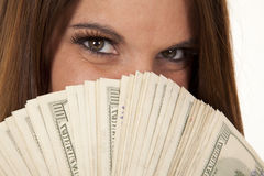 Woman eyes and hundreds Royalty Free Stock Image