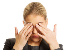 Woman with eyes pain Royalty Free Stock Images