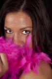 Woman eyes pnk boa Royalty Free Stock Photography