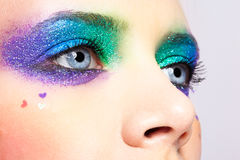 Woman eyes with shining holiday spangled makeup Stock Photography