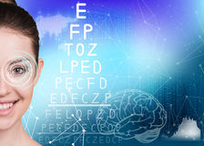 Woman on eyesight exam. With alphabet on blue background. Elements of this image furnished by NASA Stock Photography