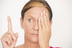 Woman Eyesight focus test on finger Royalty Free Stock Image