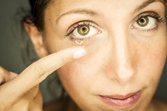 Woman and eyesight Stock Images