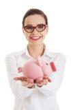 Woman in eyewear holding a piggybank Royalty Free Stock Photo