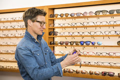 Woman in a eyewear store Royalty Free Stock Image