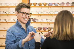 Woman in a eyewear store Royalty Free Stock Photos
