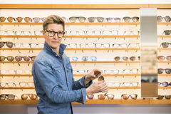 Woman in a eyewear store Stock Photos
