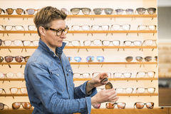Woman in a eyewear store Royalty Free Stock Images