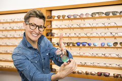 Woman in a eyewear store Royalty Free Stock Photography
