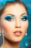 Woman face. Closeup woman face with bright blue makeup Stock Images