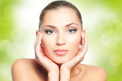 Woman face. Beautiful woman face on green nature background Royalty Free Stock Image