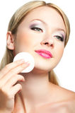 Woman face. Close-up portrait of beauty young woman cleaning her face Royalty Free Stock Photo