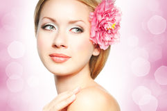 Woman face. Closeup beautiful woman face with flower Royalty Free Stock Photography