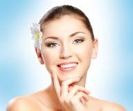 Woman face. Closeup beautiful woman face with flower Stock Photography
