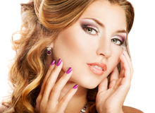 Woman face. Beautiful woman face with bright makeup and manicure Stock Photography