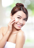Woman face and apply cream royalty free stock photos