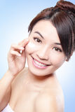 Woman face and apply cream Royalty Free Stock Photography