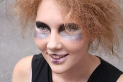 Woman face with art make-up Stock Images
