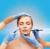 Woman face and beautician hands with pencil Stock Photography