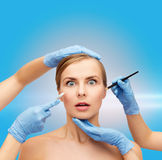 Woman face and beautician hands with pencil Royalty Free Stock Photography