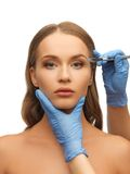 Woman face and beautician hands Stock Image