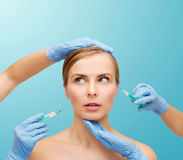 Woman face and beautician hands with syringe Royalty Free Stock Image