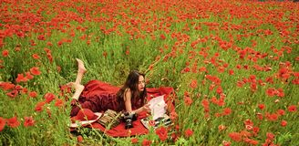 Woman face beauty. Drug, narcotics, opium, woman with typewriter, camera, book. Drug and narcotics woman in poppy flower stock photo