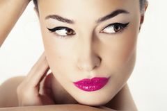 Woman face with beauty makeup. Young woman with beauty makeup, closeup studio portrait Royalty Free Stock Images