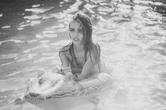Woman face beauty. Relax in luxury swimming pool. Summer vacation and travel to ocean, maldives. Fashion crocodile. Leather and girl in water. woman on sea with royalty free stock photo