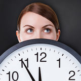 Woman face with a big clock Royalty Free Stock Photography