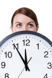 Woman face with a big clock Stock Image