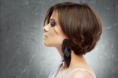 Woman face. bob haircut. profile view. beauty face . short hair. Dress. studio royalty free stock photography