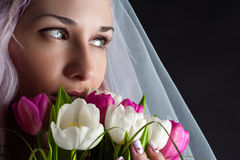 Woman face with a bouquet of tulips Stock Photos