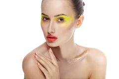 Woman face with bright yellow makeup and manicure Stock Images