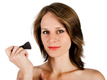 Woman face with brush Royalty Free Stock Photo