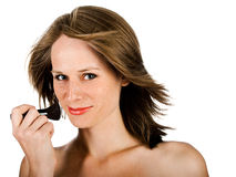 Woman face with brush Royalty Free Stock Photos