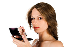 Woman face with brush Stock Images