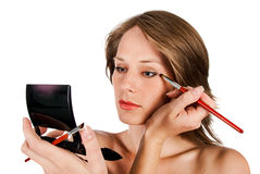 Woman face with brush Stock Photos