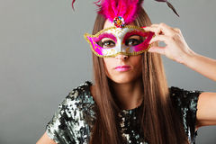 Woman face with carnival mask on gray Royalty Free Stock Image