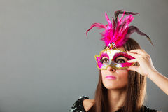 Woman face with carnival mask Stock Photo