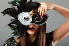 Woman face with carnival mask Stock Photos