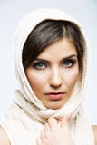 Woman face close up beauty portrait. Female model poses. On white background Royalty Free Stock Photos