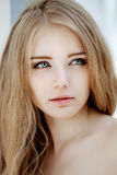 Woman face close up. A pretty young blond trendy. Girl with a be Stock Image