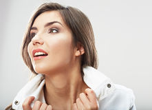 Woman face close up white backround isolated. Smiling girl port Stock Photos