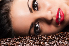 Woman face with coffee beans Royalty Free Stock Photography