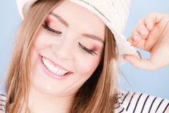 Woman face colorful eyes makeup, summer straw hat smiling Royalty Free Stock Photo