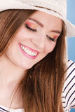Woman face colorful eyes makeup, summer straw hat smiling Royalty Free Stock Images