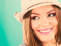 Woman face colorful eyes makeup, summer straw hat smiling Royalty Free Stock Photography