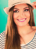 Woman face colorful eyes makeup, summer straw hat smiling Stock Photos