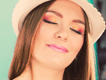Woman face colorful eyes makeup, summer straw hat smiling Stock Photography